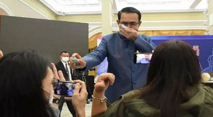 Instead of answering the question, the Thai Prime Minister sprayed journalists with sanitizer